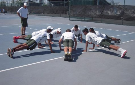 The Varsity tennis team took home the school's first State title in the 2014 season. Before each match, they partake in warm up drills such as pushups to help improve physical stamina. They open their season in April