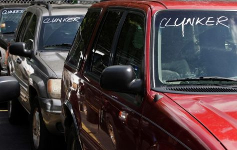 "A row of Chrysler jeeps with the word ""Clunker"" written on the windshields at a local car dealership trying to sell the older Cherokee models. These models are unaffected by the recall as they do not have the same airbag systems."