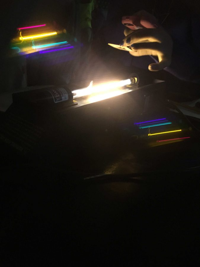 Junior+Olivia+Salach+explores+color+spectra+in+her+accelerated+chemistry+class.+The+students+are+studying+radiation+and+electrons+and+therefore+light.+Salach+takes+a+photo+with+her+phone+and+a+special+lens+that+allows+her+to+see+colors+she+ordinarily+would+not+be+able+to.+