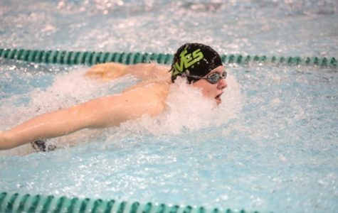 Junior Christopher Seger competes in his primary event, the 100 yard butterfly. Seger is currently ranked 13th in the GMC for the 100 butterfly with a time of :56.93. He will most likely swim a freestyle event along with his 100 butterfly. Photo by McDaniel's Photography.