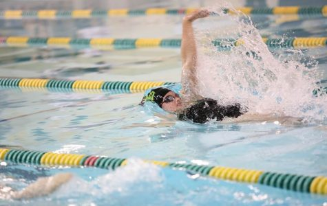 """Junior Jory Gould swims backstroke and freestyle for SHS. When the team tapers, coach Dr. Daniel Carl splits everyone into different group depending on which meet they are focusing on: GMCs, Sectionals, Districts, or States. Gould is gearing towards Districts, so she is still in the """"pre-taper"""" mode."""