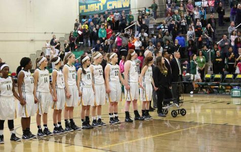 The girls varsity basketball team stands hand-in-hand during the National Anthem of their last home game against Princeton. Their season came to a close after a loss to Winton Woods in the first round of the tournament. Photo Courtesy of McDaniels Photography.