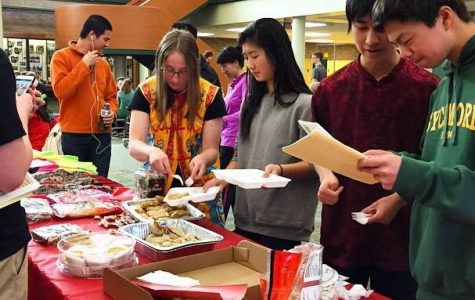 Chinese class students sell various food items during all three lunches. These items included Chinese snacks, spring rolls, and dumplings. All money raised went to the club to support their activities.
