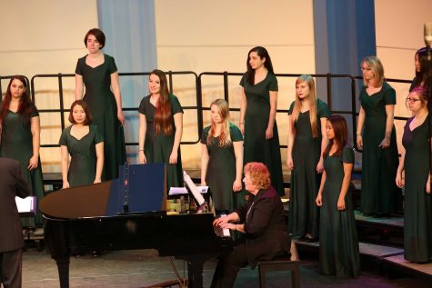 Bella Voce is singing at the spring concert. Mr. Kenneth Holdt directs the whole concert. Choirs sing separately, together, and with numerous instruments throughout the entire choir concert. Photo Courtesy of: McDaniel's Photography
