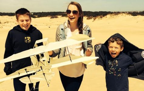 Junior Lauren Shassere and her two younger brothers enjoyed spring break last year on the sand dunes of North Carolina. Here they prepare to fly a plane shaped kite over the sand.