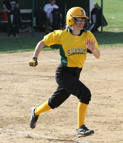 Senior Jordan Schuster runs from home to first after bunting. Schuster plays a variety of positions, including catcher, infield, and outfield. With the loss of several senior players she must step up to fill in this year. Photo Courtesy of McDaniel's Photography.