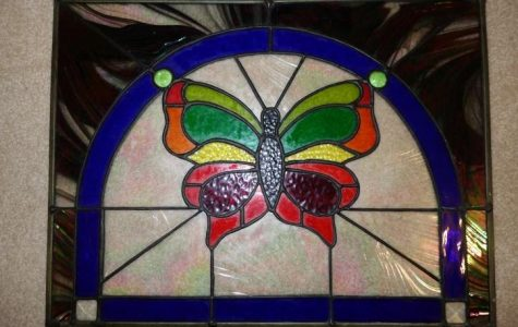 This colorful butterfly is an example of a stain glass project for beginners, which might take 5-7 weeks to complete. Students learn to select the glass, cut it, foil it, and solder the pieces together. The process is relatively simple when guided by a teacher and the right equipment is available.
