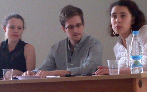 """Edward Snowden meeting with activists in Moscow. Snowden is accused of treason and has thus been in temporary Russian asylum since 2013. Despite being in hiding, he has made several significant appearences in the last year including the Academy Award winning documentary made about him, """"Citizenfour""""."""