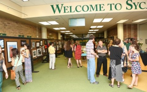 """To honor the seniors, all art and photo classes had a Senior Art Show on Fri. May 8, 2015. Each student had to submit five paintings, drawings, photos, or online cartoons that would be put on display. """"My favorite part of the art show was right after we finished setting it up. I got to sit back and see all the work my classmates had done and I honestly just said, 'Wow we're good,'"""" Senior Lisa Ruffin said. All photos by McDaniel's Photography."""