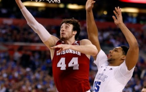 Jahlil Okafor (left) defends a Frank Kaminsky (right) layup in the National Championship in April. Both players are highly-touted prospects in the upcoming NBA Draft. Duke defeated Wisconsin in the National Championship.