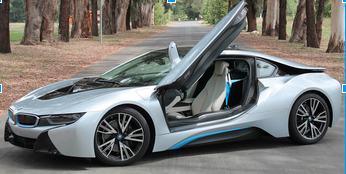 Photo courtesy of MCT  The BMW i8 in person.  The car features prominent butterfly doors and electric blue accents.  It can be bought online on BMWUSA.com