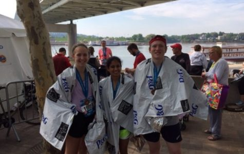 Juniors Grace Whaley, Maya Sheth, and Chris Seger immediately after completing the half marathon. The Flying Pig marathon is an annual event which occurred on May 1 to May 3. Events include the 10k, 5k, half marathon and marathon.