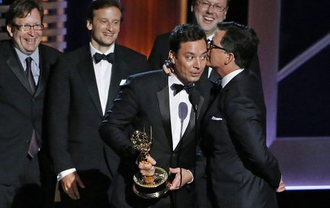 """Jimmy Fallon host of """"The Tonight Show"""" talks with Stephen Colbert host of """"The Late Show"""" at the 66th Annual Primetime Emmy Awards. While talented, both male comedians have taken over shows for other male comedians (Jay Leno and David Letterman respectively). Other male comedians who have taken over for other male comedians include Trevor Noah, James Corden, and Seth Meyers."""