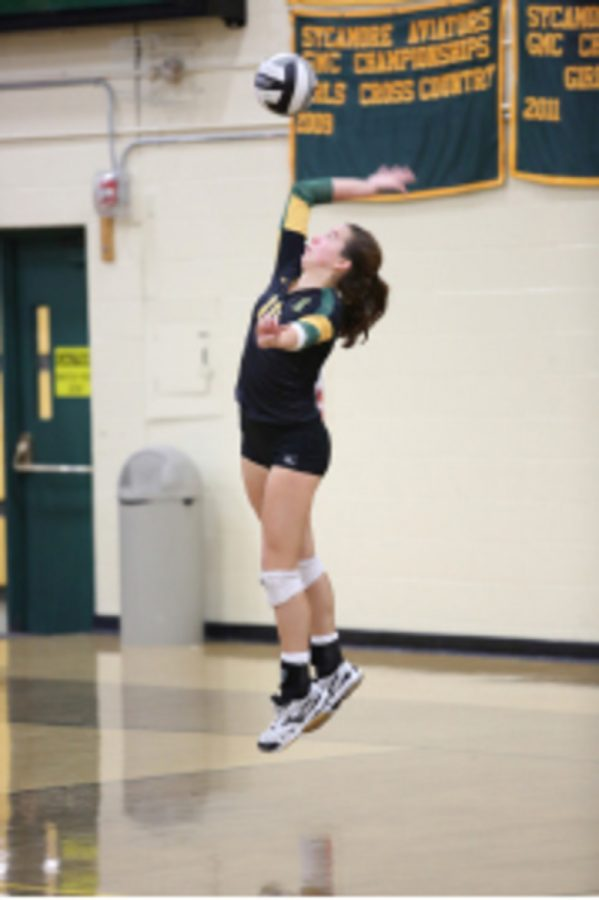 Sophomore Abbie Hughes spikes the ball to bring the ladies to their victory. The volleyball teams play best of five but the ladies won three in a row. They brought their team to a victory on the court as well as off by raising so much money for the Duke Cancer Research Center.