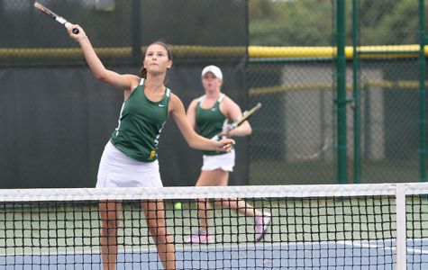 Freshman Helen Sotropa is hitting a ball back during warm ups before senior night for girls Gold Varsity tennis on Friday Sept.  25. They played Chaminade-Julienne and won 5-0. The girls went on to state on Sunday Oct. 18 and became state runner ups.