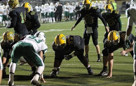 Now junior quarterback Jake Borman is getting the huddle ready before a play during last year's game v Mason on Oct. 31, 2014. SHS ended up winning the game and stopped Mason from making the playoffs. The team looks to do it again this year but not on their home turf.