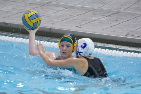 Wessinger looks to make a pass down the pool to assist a shot. Game scores from past games are posted on twitter and it is open to anyone. Click here in order to see the girl's water polo team's page. Photo courtesy of sarah Horne