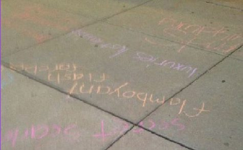 """Students getting off of the bus were quite surprised with what they saw.  Throughout the concrete walkway to the athletic wing, there was chalk.  Some of it was quite colorful, and all seemed pretty well intentioned and humorous.  Sophomore Gabby Yunsaid""""It was really funny, but it really didn't make any sense.""""  ."""
