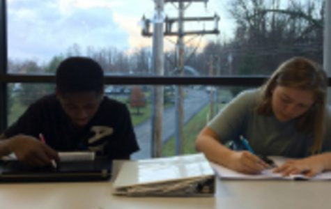 Freshman Lacell Griffin (left) and Junior Chloe Bradley (right) work on homework side by side every day during third bell. They like to go out in the hallway to focus in a quieter environment. Fast Track is a dually beneficial program for both mentors and mentees.