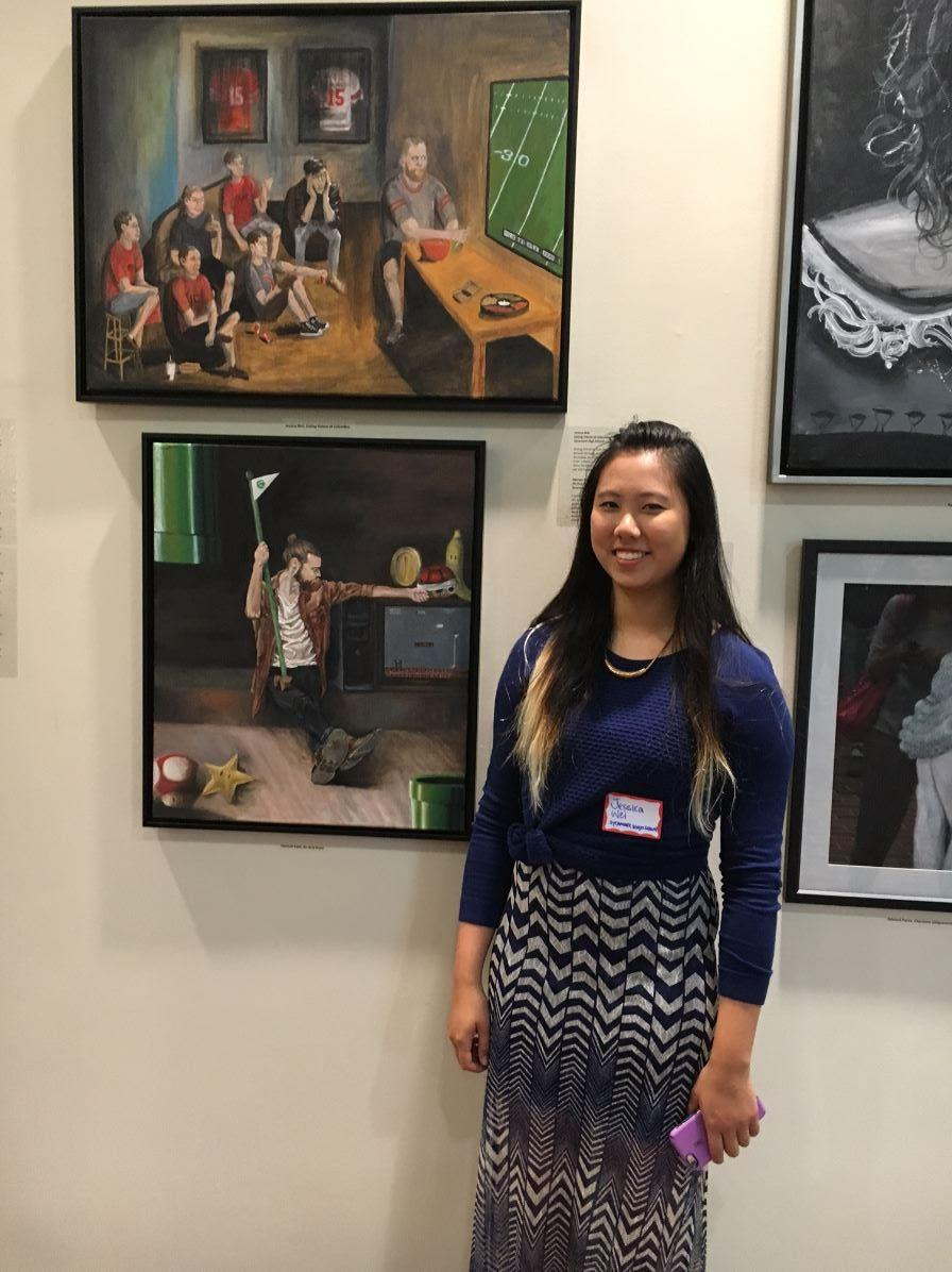 First place winner, Jessica Wei. Her painting is featured above her head to the left.