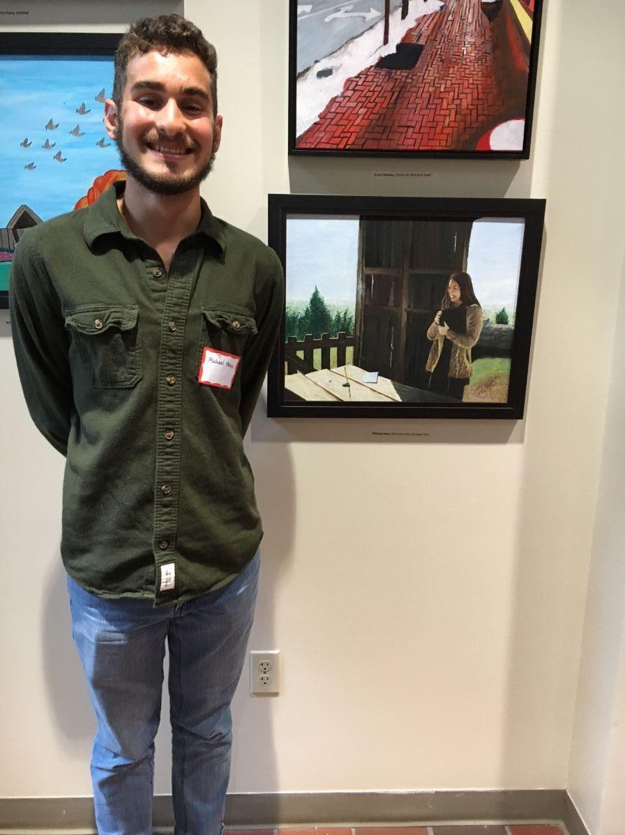 Michael Heyn (12) and his painting of Brooke Baker (11).
