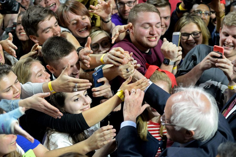 Supporters+for+Senator+Bernie+Sanders+swarm+the+candidate+at+a+rally.+Sanders+has+become+more+of+a+rock-star+as+the+campaign+has+gained+speed.+Unfortunately%2C+this+leaves+many+to+pay+more+attention+to+the+idea+of+him+than+what+his+politics.