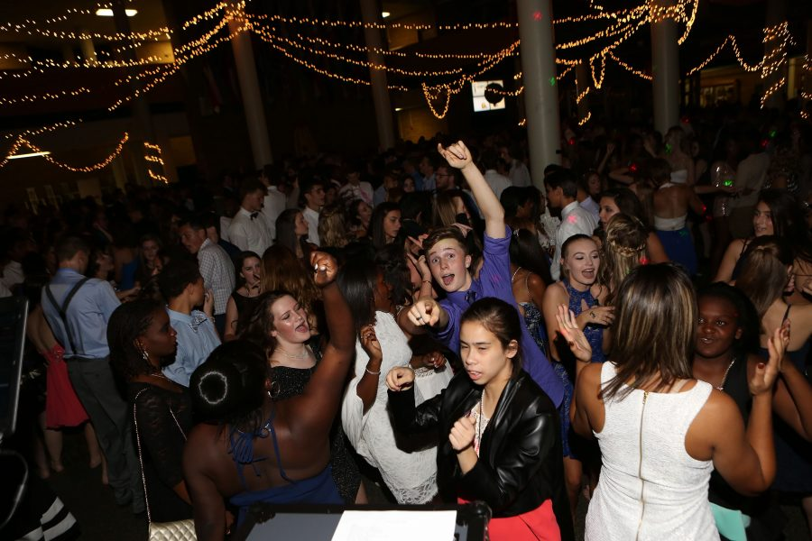 Dancing the Night Away. Christian Thompson (9) points at the camera as students fill the commons dancing at homecoming on Saturday October 8th. Students danced, sang along to songs, talked, and greeted the homecoming court at the 2016 homecoming dance.