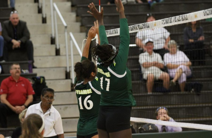 Block+Party.+Blocking+a+crucial+hit%2C+Fanta+Kouyate%2C+12%2C+saves+yet+another+play+for+the+team.+Kouyate+is+looking+to+play+volleyball+in+college%2C+most+likely+at+Western+Nebraska.+The+team+will+miss+Kouyate+and+its+other+seven+seniors+in+2017.+