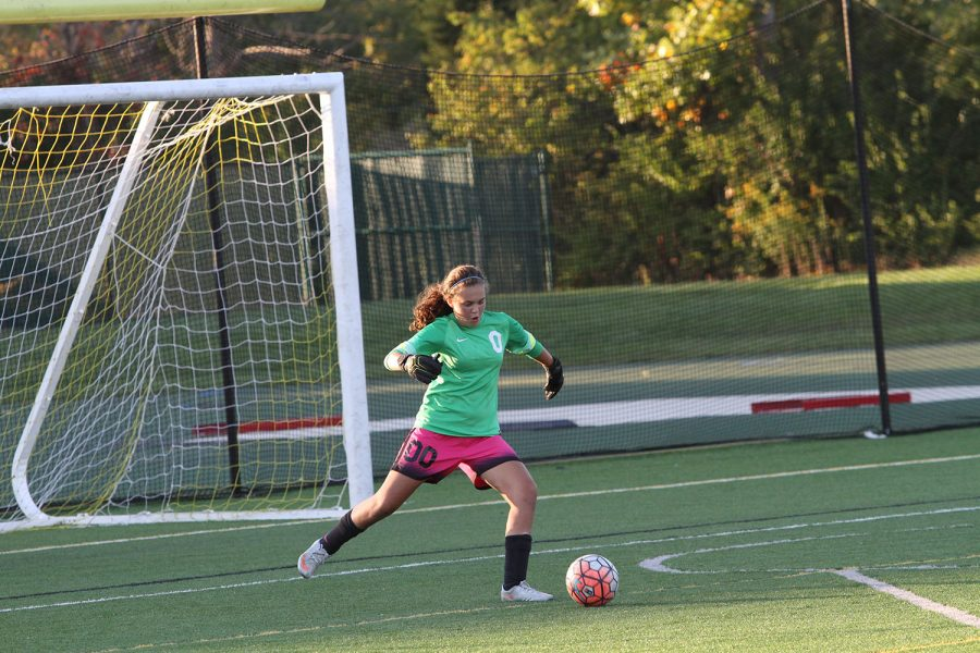 Guarding the goal. Gabby Khodadad (9) kicks the ball at the JV girls Pink out game on Thursday, October 6th. The team played against Colerain. She has been playing for many years, working to improve her skills and hopefully become a Varsity goalie.