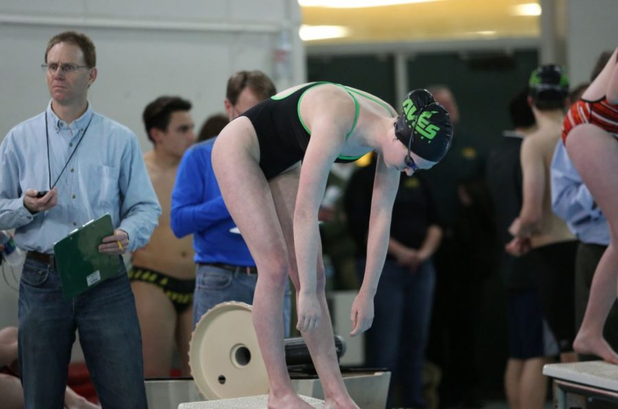 Junior Madison Forsthoefel prepares for her 200 freestyle at a meet earlier in the season. Foresthoefel will swim the 200 IM and the 200 freestyle at GMC's.  This is her third year on the team.