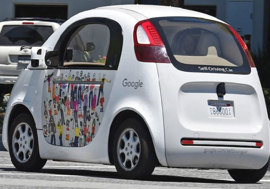 This+is+Google%E2%80%99s+self+driving+car-+Waymo.+Google+plans+for+this+car+to+be+released+to+everyone+by+2020.+The+design+on+the+side+was+created+by+Kate+Thompson+for+the+Paint+the+Town+art+experiment.