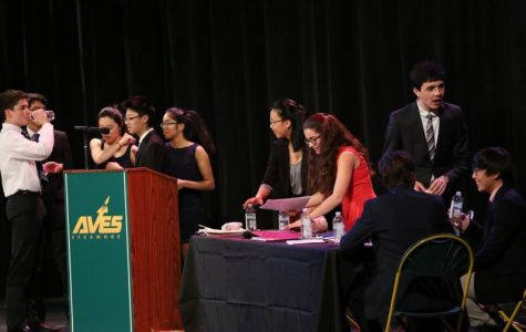"""SPEAK UP. The final debate was hosted sixth bell in the Little Theater and was watched by most sophomores and other students. English teachers and previous debate winners judged the debate. """"It's definitely helped my persuasive writing, and a lot of my group members are now better public speakers as well because of it,"""" Zhang said."""