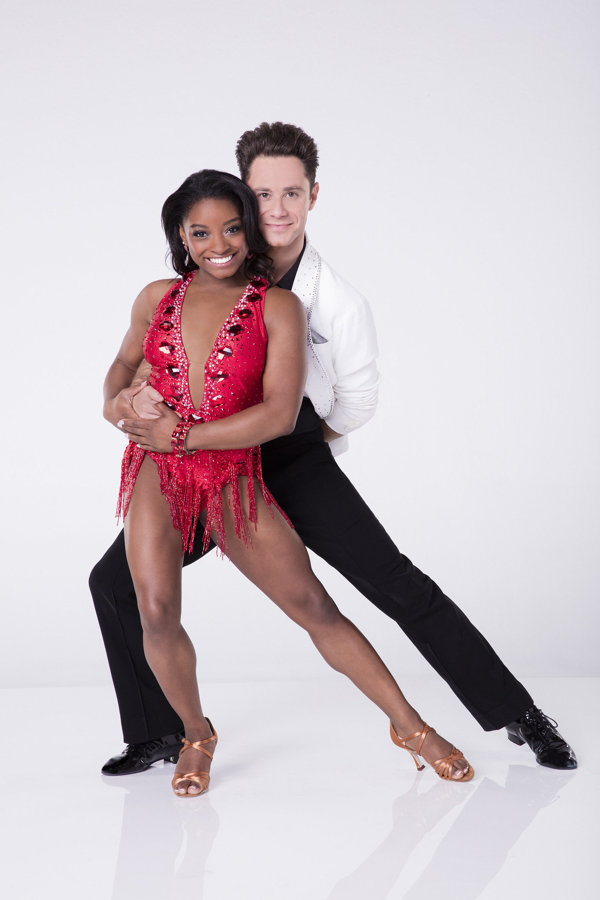 "PICTURE PERFECT Simone Biles poses with her dance partner Sasha Farber for ""Dancing with the Stars"" (DWTS) pictures. Biles is not the first gymnast from her group, the Final Five, to compete in DWTS. Laurie Hernandez, 16, won the mirror ball trophy last year."
