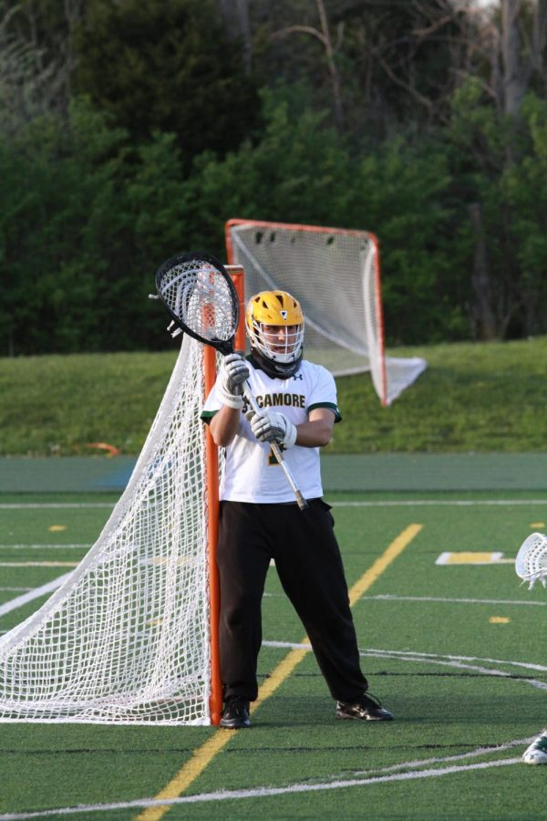 SAVE.+Evan+Schuster%2C+12%2C+is+the+goalie+for+the+Varsity+boys%E2%80%99+Lacrosse+team.+He+has+recently+committed+to+Indiana+Tech+for+lacrosse.+He+is+also+the+second+all-time+goalie+for+career+saves.