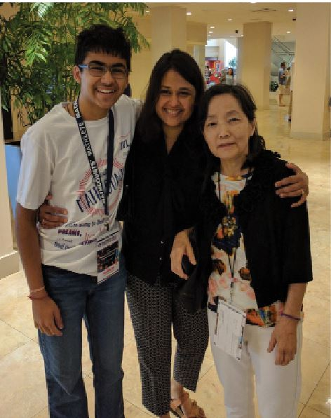 ALL SMILES. Verma celebrates along with his mother and professor at the MATHCOUNTS Nationals. At the competition, Verma ranked 29th place. The competition consisted of students in grades six, seven, and eight.
