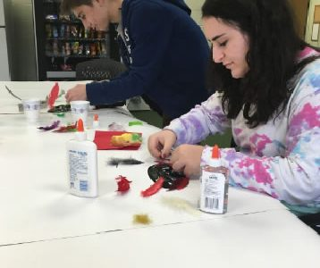 CREATIVITY. French club participates in seasonal activities throughout the year. Students made masks for Mardi Gras, collected donations after the hurricane in Haiti, and made gingerbread houses in December. This year, the club hopes to continue it's engaging activities.