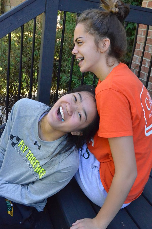 """LAUGH OUT LOUD. JV defensive specialist Meredith Ringer and Varsity defensive specialist Anna Helker often hang out outside of volleyball practice. Helker is Ringer's big sister again. Though the girls are two grade levels apart, they are now best friends. """"As an underclassmen, I love having a 'big sis' to look up to. If you have a question, they're there, not only on the court but throughout the school day,"""" Ringer said. Photo by Meredith Ringer."""