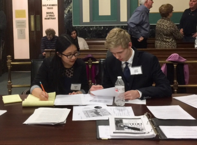 COURT+SIDE+SEATS.+Seniors+Jenna+Bao+and+Adam+Meller+prepare+at+counsel+table+at+district+competition.+Both+seniors+have+been+in+the+program+since+freshman+year.+The+two+attorneys+were+on+the+side+of+the+defense+this+season+and+competed+against+St.+Ursula+Academy.+Photo+courtesy+of+Yan+Xu.+