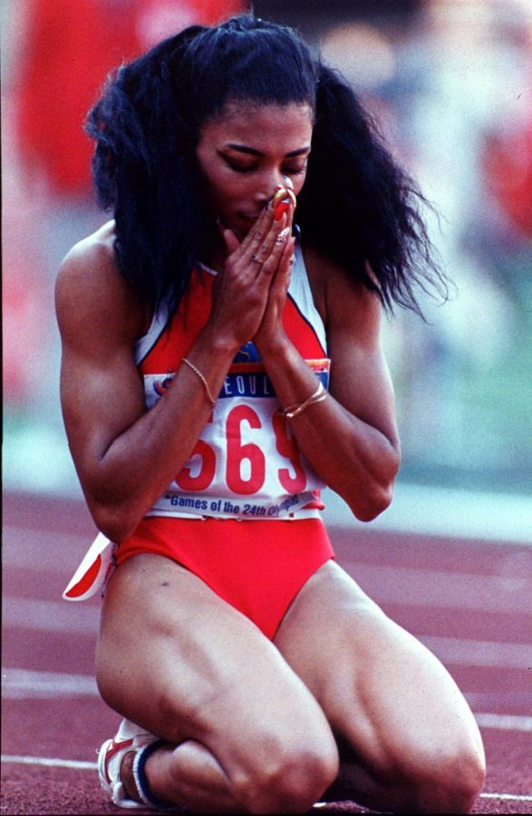 SPRINT. Joyner falls to her knees after winning gold. She is at the 1988 Seoul Olympics, and her 200 meter record is still the top time for any women since then. Because of this, she is considered one of the fastest women of all time.