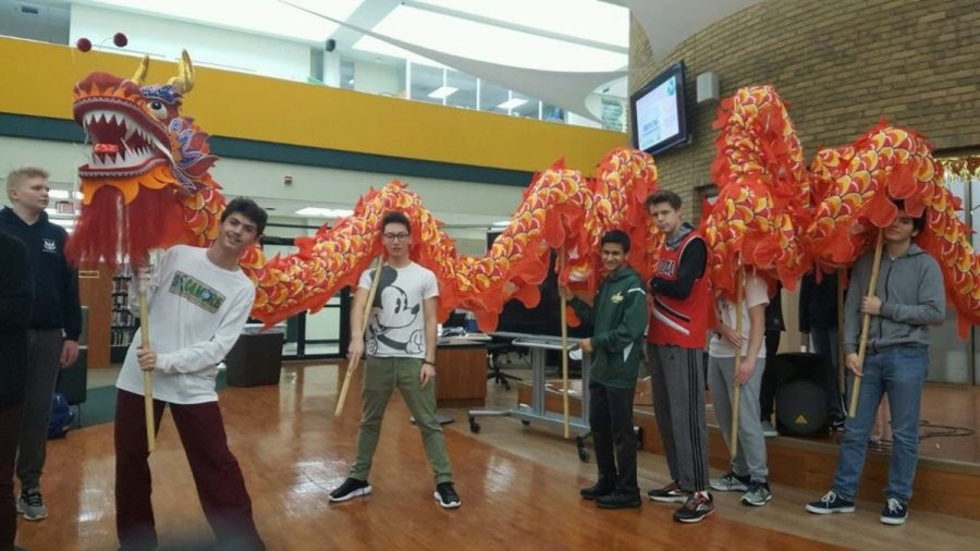 CELEBRATING CULTURE. Students in Chinese class perform with Chinese Club's traditional dragon costume. The dragon dance is traditionally performed during the Lunar New Year, but the dragon is an important element of the culture in general. Language clubs are celebrated on the first day of the Diversity Week, March 19.