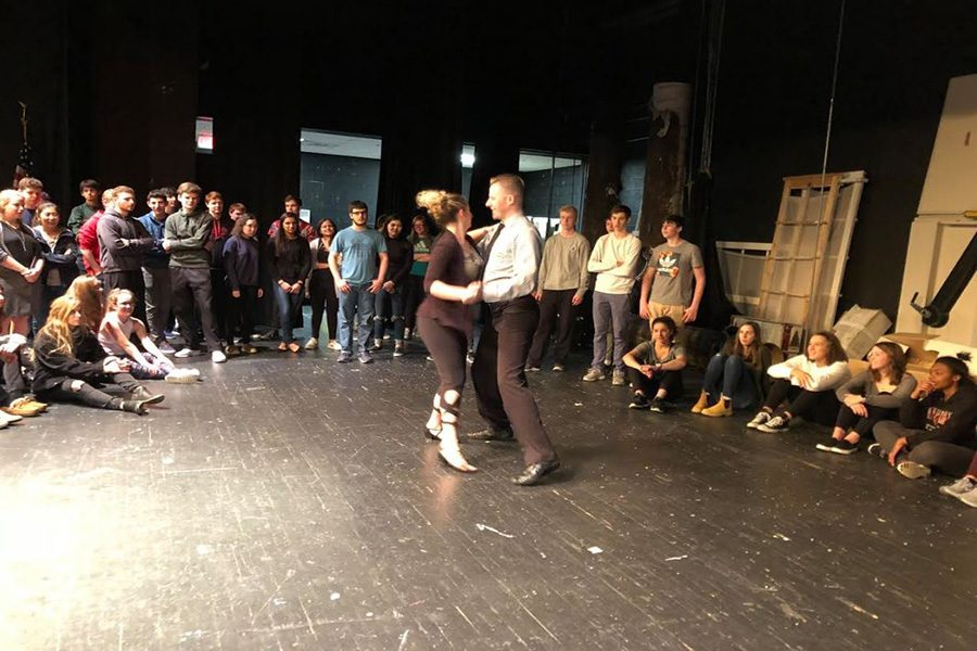 DANCE. Spanish students watch as Jeremy Mainous and Carrie Means perform their own salsa routine. Gathered in the Little Theatre, AP Spanish and CHS missed fifth bell and lunch in order to learn more about the dancing aspect of Hispanic cultures. Smiling and dancing, students had a great time learning.