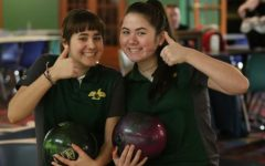 THUMBS UP. Junior Paige Weitz and sophomore Nova Dugan-Mezensky smile at the camera while practicing. This year, SHS's girls bowling team is made up of only three girls: Weitz, Dugan-Mezensky, and junior Rachel Izworski. Weitz represented them at state.