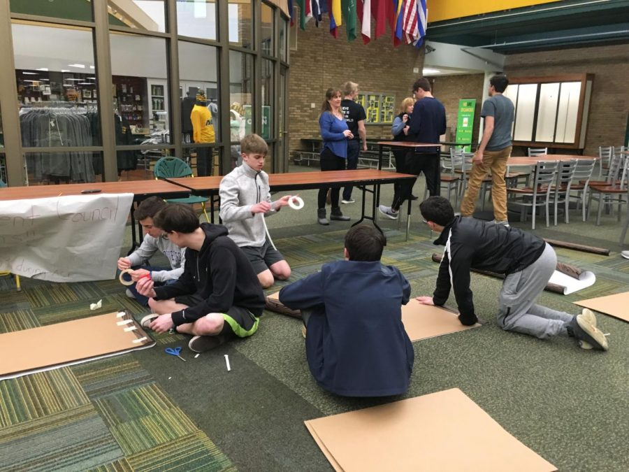 HELPING OUT. Students help prepare and set up After Prom decorations in the Commons. After Prom is run by PTO members and will take place directly after prom. Tickets are on sale for $20 during lunch.