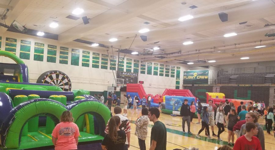HAVING FUN. Juniors and seniors explore the inflatables in the gym during After Prom on April 29. The event, hosted by the PTO, ran from midnight until 4:00 a.m. There were many other activities such as Kahoot, two hypnotist shows, gambling stations; there were raffles, and food was provided.