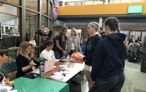 TICKETS. Student Council and PTO members sit at the tables in the Commons, selling tickets for Prom and After Prom during lunch. Prom tickets cost $35 while After Prom tickets cost $20. Money from sales will help fund the events.