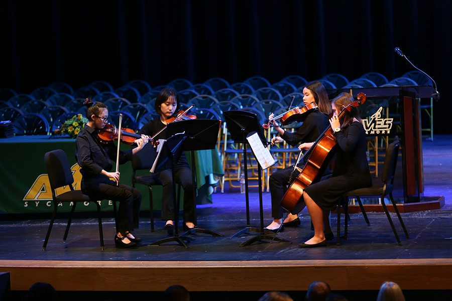 POMP AND CIRCUMSTANCE. A Sycamore String Quartet plays Pomp and Circumstance leading into senior recognition night. The group's conductor is Dr. Angela Santangelo. The quartet includes Esther Ku, violin, Heather Song, violo, So Eun Cho, violin, and Alice Lundgren, cello.