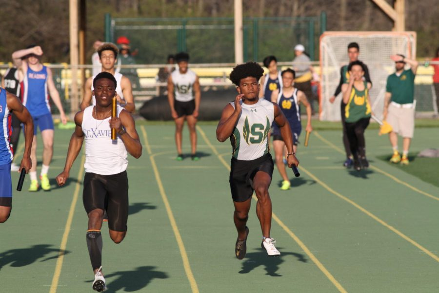 KEEP RUNNING. Senior Jonathon Malek competes in the 4x200 relay. Last year, Malek won state with senior Asa Hodrick. They won the 4x200 relay, so they were determined to qualify again this year.