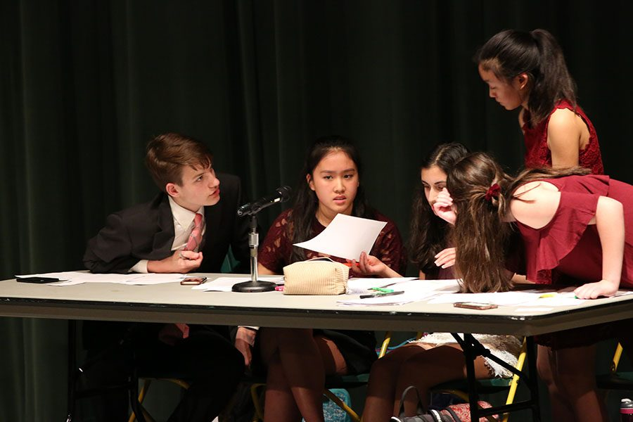 """TOUGH AS NAILS. Debates start off with four constructive speeches for their respective sides and have five minutes to prepare their rebuttals. """"Debates were really crazy while they were happening, but I kind of miss them now,"""" said Anisa Khatana, 10."""