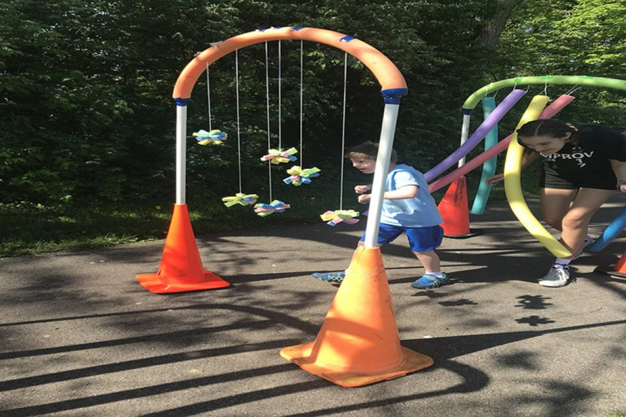 OBSTACLE COURSE. Students in TPA created this activity for field day. The course accommodated all students. Some of the items making up the course included pool noodles, cones, hoops, and sponges.
