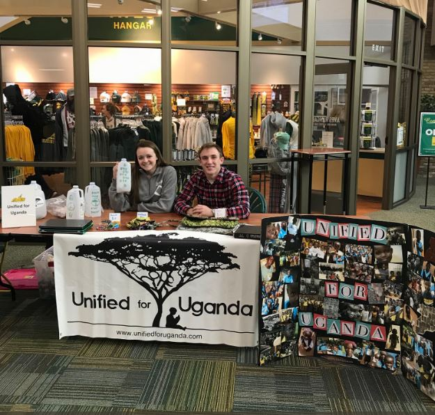 TRANSITION. Former U4U officers seniors Julia McDowell and Jeremy Pletz are at a fundraising booth for sponsoring a Ugandan children. Officers were replaced through submissions and were announced. Next year has high expectations awaiting U4U.